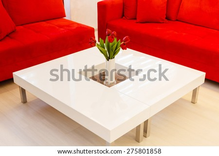 Modern table with red  flowers - stock photo