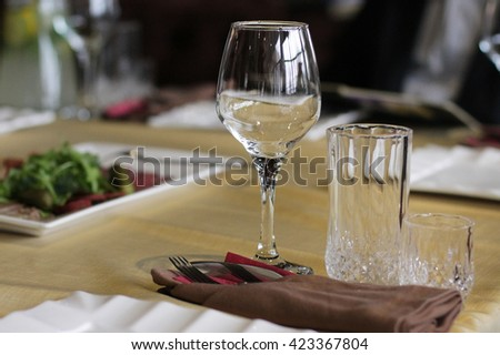 Modern tableware and glasses on a table - stock photo