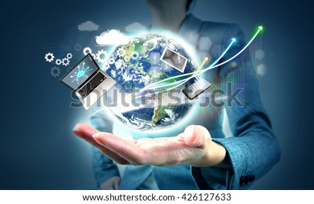 Modern technology in hand.  Elements of this image furnished by NASA