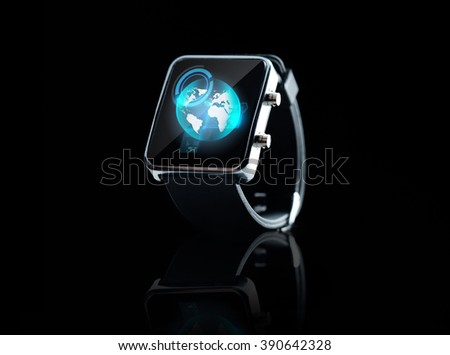 modern technology, object and mass media concept - close up of black smart watch with earth globe projection on screen - stock photo