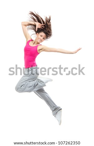 Modern teenage girl dancer jumping and dancing hip-hop isolated on a white background