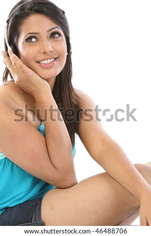 Modern teenage girl hearing music with headphones - stock photo