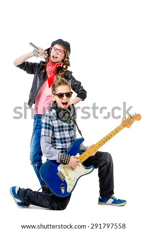 Modern teenagers playing electric guitar and sing on a stage with expression. Isolated over white.  - stock photo