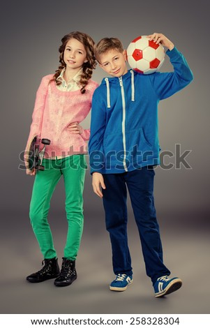 Modern teenagers posing together. Active generation. Full length portrait. Studio shot.  - stock photo