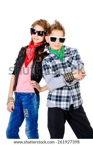 Modern teenagers posing together. Studio shot.  - stock photo