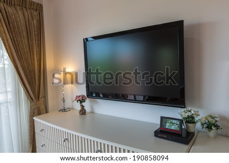Modern television in living room - stock photo