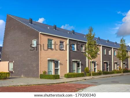Modern Terraced Houses Neighborhood in Various Colors - stock photo