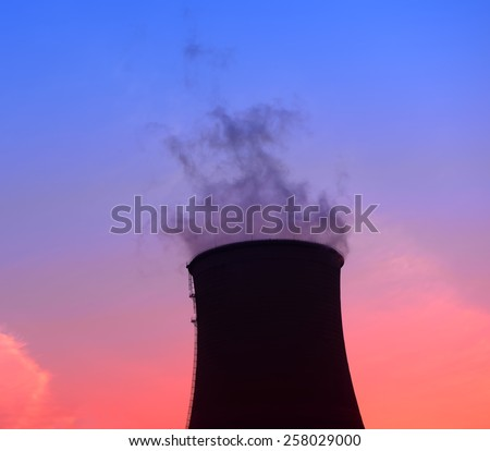 Modern thermal power plant under the setting sun