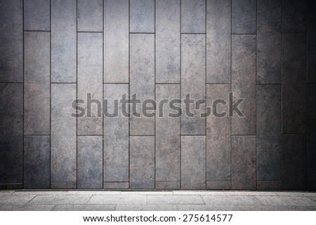 Modern tile wall and sidewalk