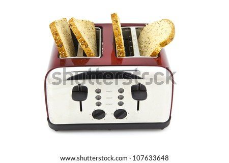 Modern toaster with bread slices on white background - stock photo