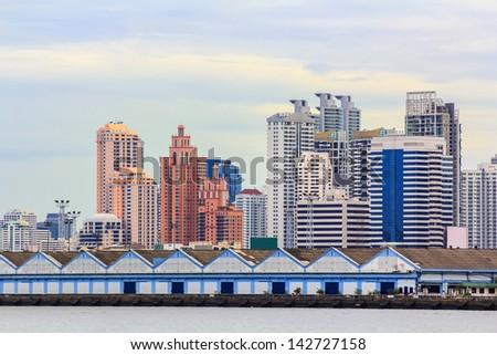 Modern Town at Bangkok beside river in Thailand - stock photo