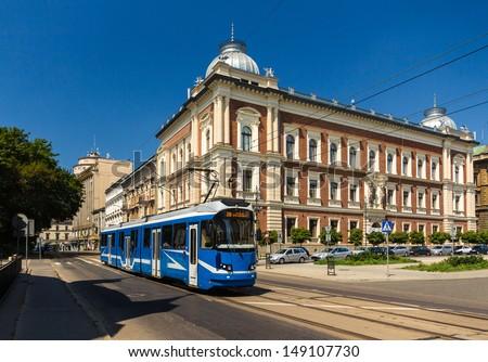 Modern tram EU8N in Krakow - Poland - stock photo