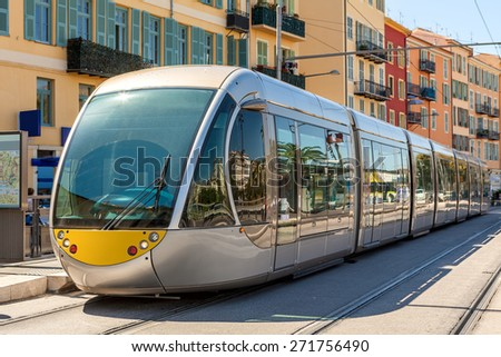 Modern tram on the stop in city of Nice, France. - stock photo