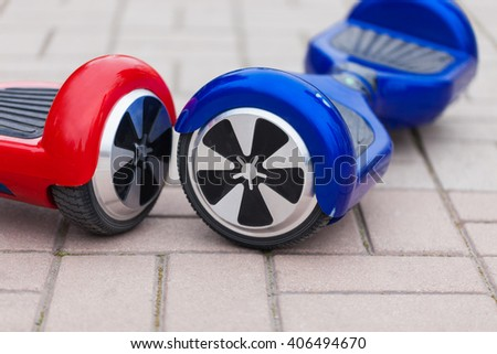 Modern transportation technology - electric mini segway scooter hover board.Easy and fun way to ride the city streets.This is the future of personal urban transport free of air pollution - stock photo
