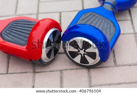 Modern transportation technology - electric mini segway scooter hover board. Easy and fun way to ride the city streets.Trending new gadget that became very popular and produces no air pollution - stock photo