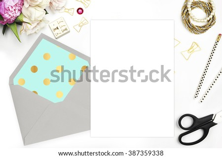 Modern trend template for advertising. Desktop workplace designer, painter top view. Product mock-up.  Glamour style. Gold and stationery items on white table. Flat lay. Wedding template invitation. - stock photo