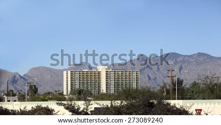 Modern Tucson downtown high rise residential housing with Santa Catalina mountain range in background, Arizona - stock photo