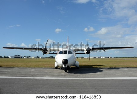Modern turboprop airplane on the ground front view