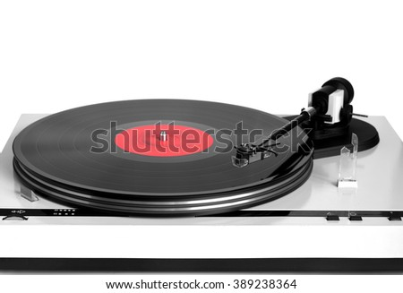 Modern turntable in silver case with rotation vinyl record with red label isolated on white background. Horizontal photo front view closeup - stock photo