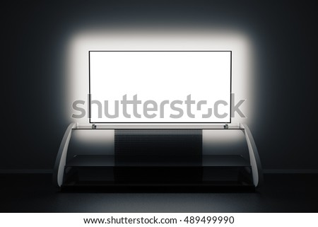 Modern TV stand and empty illuminated flat screen in dark room. Front view, Mock up, 3D Rendering
