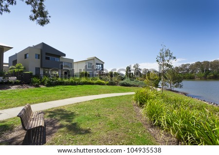 Modern two story Australian house front overlooking a park and river - stock photo