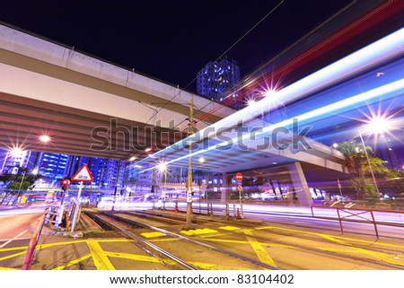 modern urban city at night with traffic