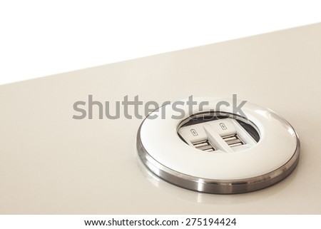 Modern usb dock built in table, made of plastic and metal ring as decoration.