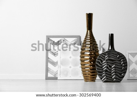 Modern vases on floor in room - stock photo