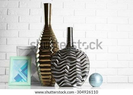 Modern vases on floor in room