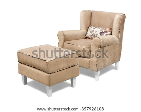 Modern velvet armchair with ottoman tabouret isolated on white with clipping path