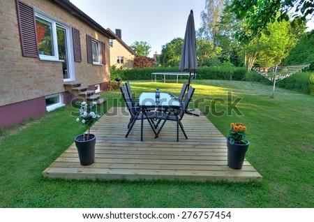 Modern villa backyard with garden furniture - stock photo