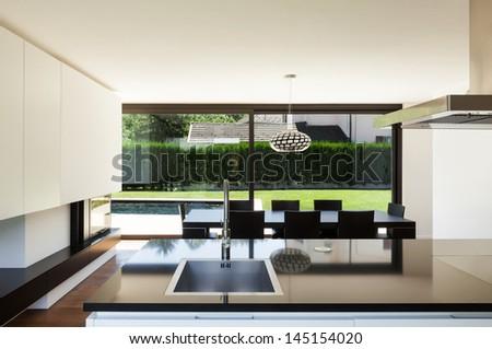 Modern villa, interior, view room from kitchen - stock photo