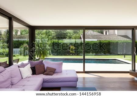 Modern villa, interior, wide living room with divan - stock photo