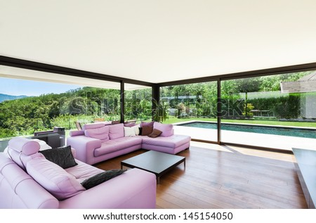 Modern villa, interior, wide living room with pink divan - stock photo