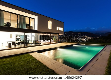 Modern villa, night scene,view from poolside