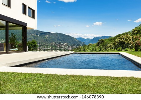 Modern villa , outdoor, view from poolside - stock photo