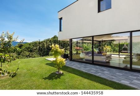 Modern villa, outdoor, view from the garden - stock photo