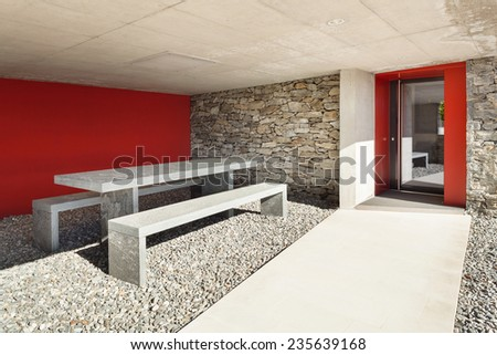 Modern villa, porch with table and bench stone, outdoor - stock photo