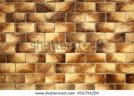 Modern Vintage Stone Tiled Wall From Rectangular Textures Tiles Background In Brown Yellow Color, Close Up, Copy Space, Construction Finishing Materials, Home House Building Exterior. - stock photo