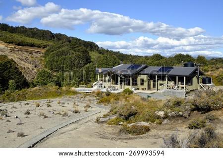 Modern Waihohonu Hut on Tongariro great walk in New Zealand. - stock photo