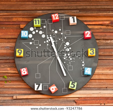 modern wall clock on wooden background