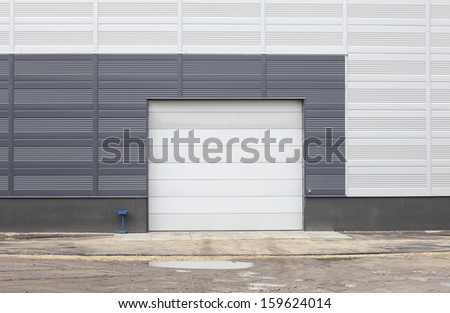 Modern warehouse - central composition of gate - stock photo