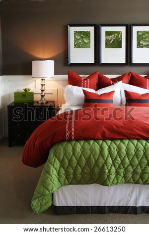 Modern, warm, inviting bedroom or hotel room. - stock photo