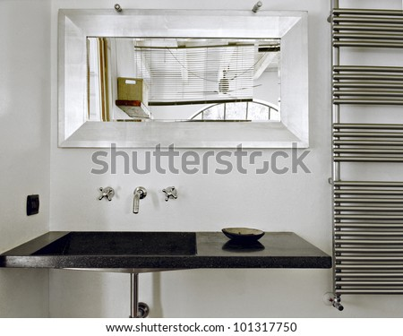 modern washbasin for a bahtroom with a mirror - stock photo