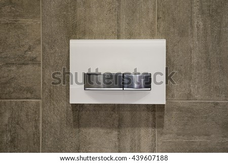 Modern washout buttons on the wall - stock photo