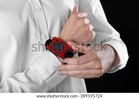 Modern watch on a woman's wrist, close up - stock photo