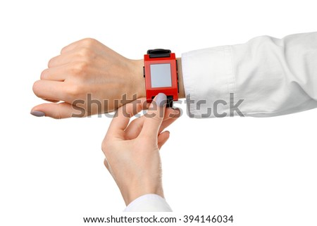 Modern watch on a woman's wrist isolated on white - stock photo