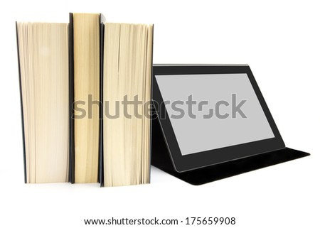 Modern way of reading concept. Books and a tablet device.