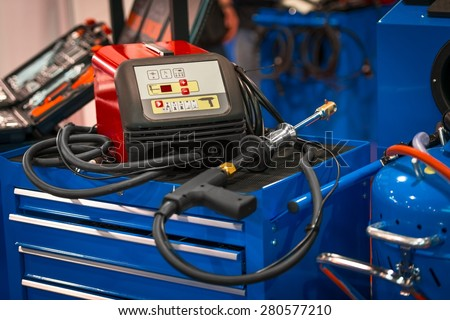 Modern welding gun on blue box closeup photo - stock photo