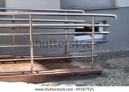 Modern wheelchair ramp in church door - stock photo